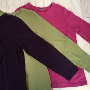 Three long sleeve T-shirts purple, green and pink